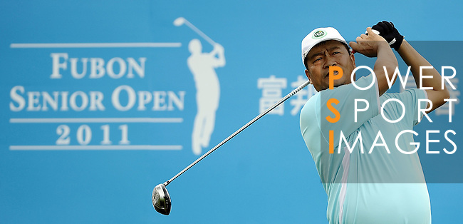 TAIPEI, TAIWAN - NOVEMBER 19:  Lin De Ming of Taiwan tees off on the 1st hole during day two of the Fubon Senior Open at Miramar Golf & Country Club on November 19, 2011 in Taipei, Taiwan.  Photo by Victor Fraile / The Power of Sport Images
