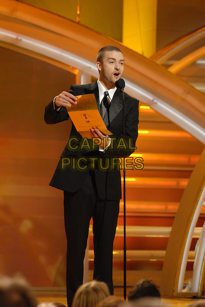 """JUSTIN TIMBERLAKE.Presents the Best Original Song In A Motion Picture.Telecast - 64th Annual Golden Globe Awards, Beverly Hills HIlton, Beverly Hills, California, USA..January 15th 2007. .globes full length stage microphone black suit.CAP/AW.Please use accompanying story.Supplied by Capital Pictures.© HFPA"""" and """"64th Golden Globe Awards"""""""
