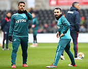 17th March 2018, Liberty Stadium, Swansea, Wales; FA Cup football, quarter-final, Swansea City versus Tottenham Hotspur; Leon Britton and Wayne Routledge of Swansea City talk during warm up
