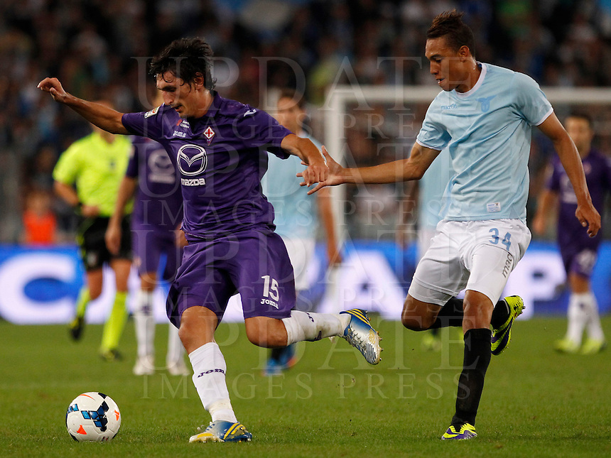 Calcio, Serie A: Lazio vs Fiorentina. Roma, stadio Olimpico, 6 ottobre 2013.<br /> Fiorentina defender Stefan Savic, of Montenegro, is challenged by Lazio forward Brayan Perea, of Colombia, right, during the Italian Serie A football match between Lazio and Fiorentina at Rome's Olympic stadium, 6 October 2013.<br /> UPDATE IMAGES PRESS/Isabella Bonotto
