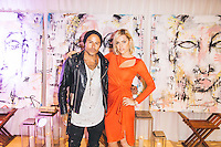 "Sophie Monk and Louis Carreon attend Carreon's unveiling of his new art installation, ""Faces,"" at the Mondrian Hotel."