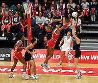28.10.2014 Silver Ferns Bailey Mes and England's Geva Mentor in action during the Silver Ferns V England netball match played at the Rotorua Events Centre in Rotorua. Mandatory Photo Credit ©Michael Bradley.