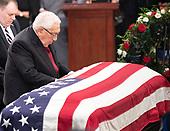 Former United States Secretary of State Henry Kissinger pays respects to the late US Senator John McCain (Republican of Arizona) during the Lying in State ceremony honoring  in the US Capitol Rotunda in Washington, DC on Friday, August 31, 2018.<br /> Credit: Ron Sachs / CNP<br /> <br /> (RESTRICTION: NO New York or New Jersey Newspapers or newspapers within a 75 mile radius of New York City)