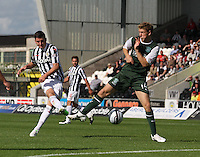 Kenny McLean shoots at David Wotherspoon in the St Mirren v Hibernian Clydesdale Bank Scottish Premier League match played at St Mirren Park, Paisley on 18.8.12.
