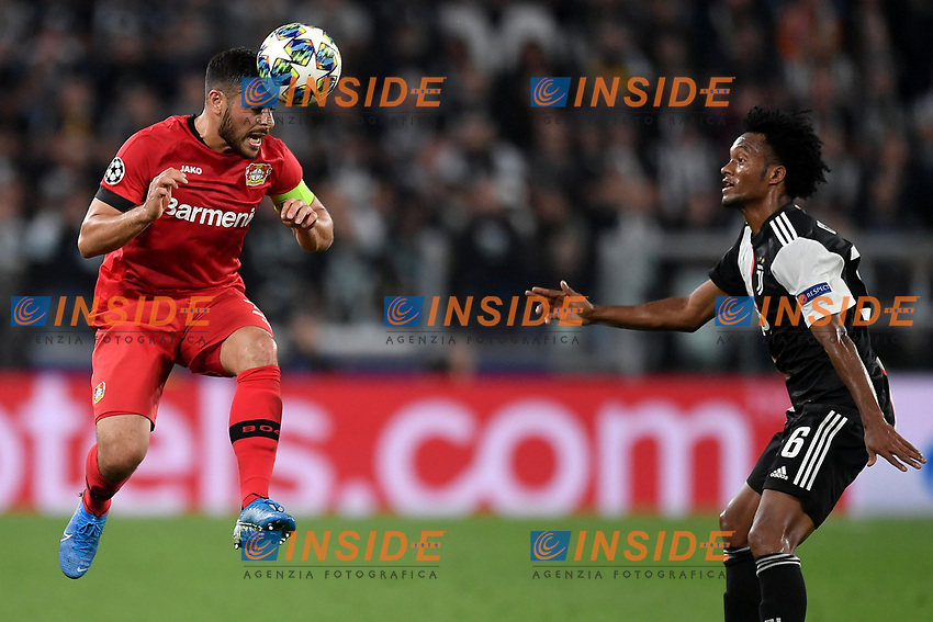 Panagiotis Retsos of Leverkusen , Juan Cuadrado of Juventus <br /> Torino 01/10/2019 Juventus Stadium <br /> Football Champions League 2019//2020 <br /> Group Stage Group D <br /> Juventus - Leverkusen <br /> Photo Andrea Staccioli / Insidefoto