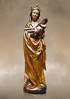 Gothic wooden statue of Madonna and Child from Bohemia, circa 1530-1540, tempera and gold leaf on wood,.  National Museum of Catalan Art, Barcelona, Spain, inv no: MNAC  65506. Against a art background.