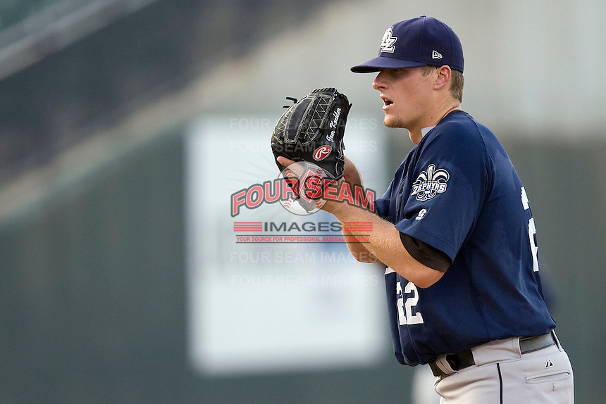 New Orleans Zephyrs pitcher Tom Koehler #22 prepares to  deliver a pitch during a game against the Round Rock Express at the Dell Diamond on July 20, 2011 in Round Rock, Texas.  New Orleans defeated Round Rock 14-11.  (Andrew Woolley/Four Seam Images)
