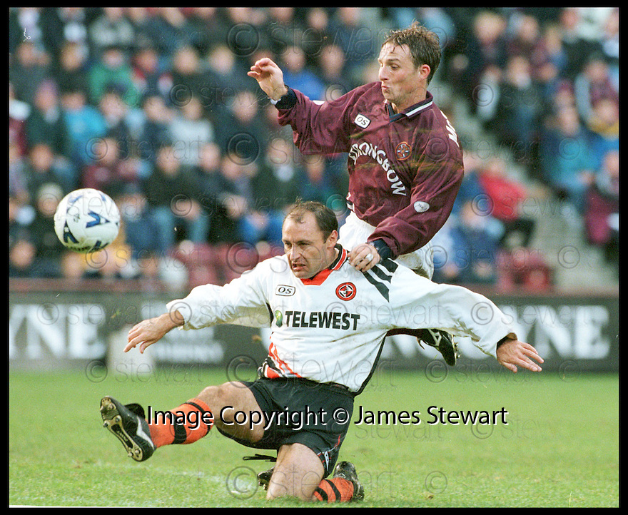 24th October 98      .Copyright Pic : James Stewart   .HEARTS V DUNDEE UTD.MAURICE MALPAS CLEARS FROM GARY MCSWEGAN........Payments to :-.James Stewart Photo Agency, Stewart House, Stewart Road, Falkirk. FK2 7AS      Vat Reg No. 607 6932 25.Office : 01324 630007        Mobile : 0421 416997.If you require further information then contact Jim Stewart on any of the numbers above.........