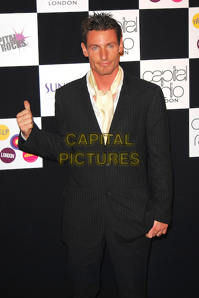 DEAN GAFFNEY.At the Capital Rocks! Party, .Battersea Park Events Arena, London, .England, December 12th 2006..half length thumb hand gesture.CAP/CAN.©Can Nguyen/Capital Pictures