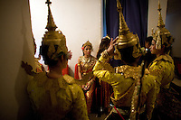 June 6th, 2008_Phnom Penh, Cambodia_ Dance troop members from the National School of Fine Arts, wait back stage, during the performance of the newly revived work of Preah Anruch Preah Neang Ossa.  It has been some 50 years, since this classical Khmer dance piece was performed publicly and is being produced by the Amrita Performing Arts Association.   Photographer: Daniel J. Groshong/Tayo Photo Group