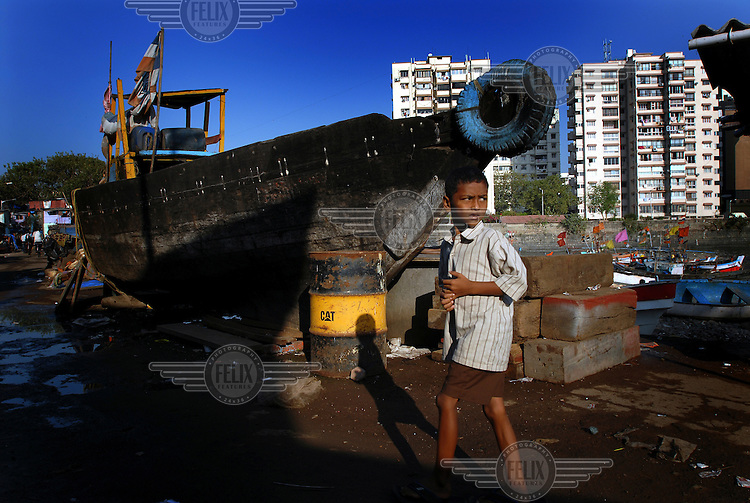 A boy in the shanty settlement in Colaba District.