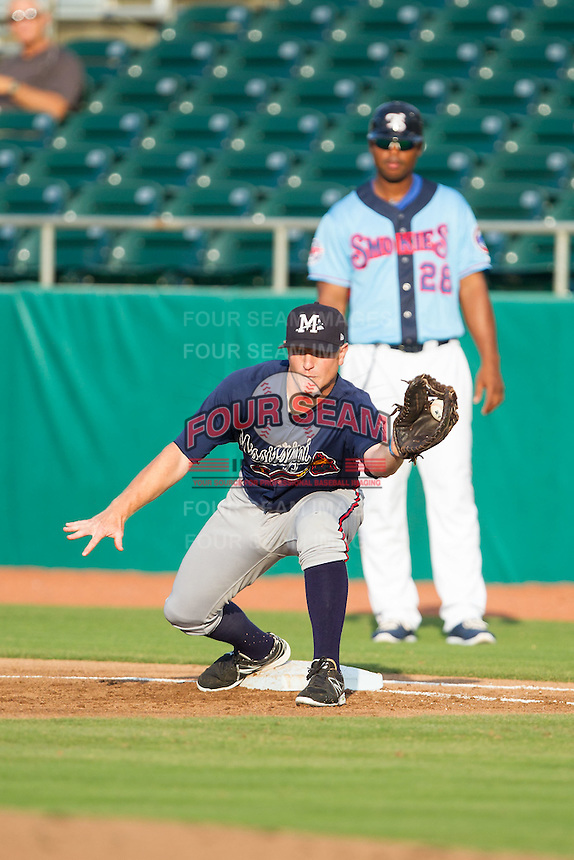 Mississippi Braves first baseman Barrett Kleinknecht (5) stretches for a throw during the game against the Tennessee Smokies at Smokies Park on July 22, 2014 in Kodak, Tennessee.  The Smokies defeated the Braves 8-7 in 10 innings. (Brian Westerholt/Four Seam Images)