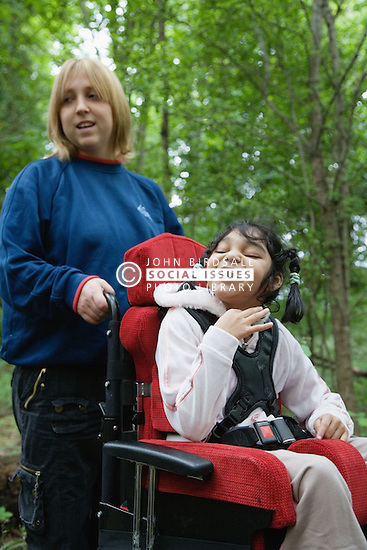 Child with cerebral palsy and her carer,