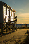 Plum Bank Road, Route 154, Saybrook, CT.  Beach front raised house and staircase silhouetted.