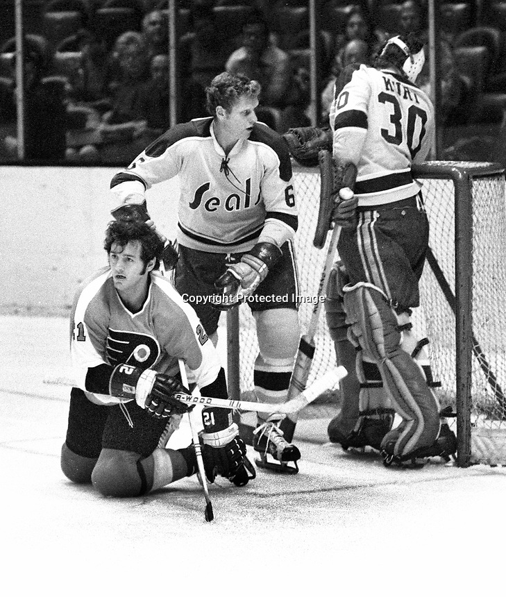 Seals vs Flyers: Seals #6 Ken Baird, Flyer goalie Gary Kurt and #21 Serge Bernier..(photo/Ron Riesterer)
