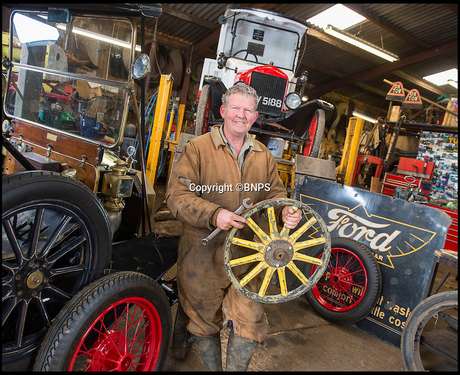 BNPS.co.uk (01202 558833)<br /> Pic: PhilYeomans/BNPS<br /> <br /> Wooden wheels.<br /> <br /> Garage that time forgot...<br /> <br /> Business is booming at Neil Tuckets time warp garage in the heart of Buckinghamshire - Where you can by any car…as long as its a Model T Ford.<br /> <br /> Despite his newest models being nearly 90 years old, Neil struggles to keep up with demand with customers snapping up one a week, despite their rudimentary levels of comfort and trim.<br /> <br /> Neil sources his spares from all over the globe and carefully puts the machines back together again.<br /> <br /> 'There like a giant meccano set really, and so beautifully simple and reliable they just won't let you down...You also don't require road tax or and MOT!'