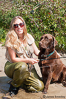 Girl flyfishing with chocolate lab