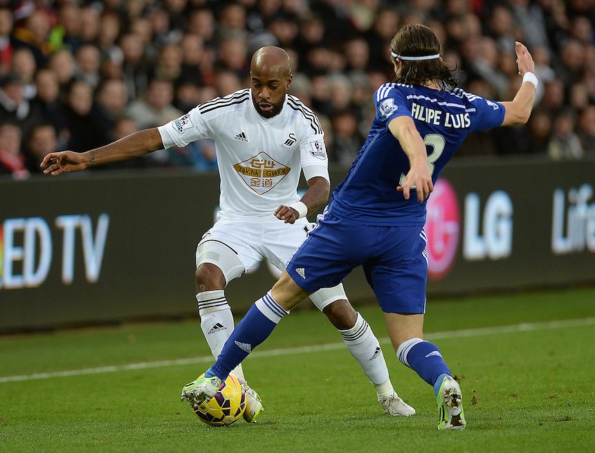 Swansea City's Dwight Tiendalli is tackled by Chelsea's Filipe Luis<br /> <br /> Photographer /Ashley CrowdenCameraSport<br /> <br /> Football - Barclays Premiership - Swansea City v Chelsea - Saturday 17th January 2015 - Liberty Stadium - Swansea<br /> <br /> &copy; CameraSport - 43 Linden Ave. Countesthorpe. Leicester. England. LE8 5PG - Tel: +44 (0) 116 277 4147 - admin@camerasport.com - www.camerasport.com