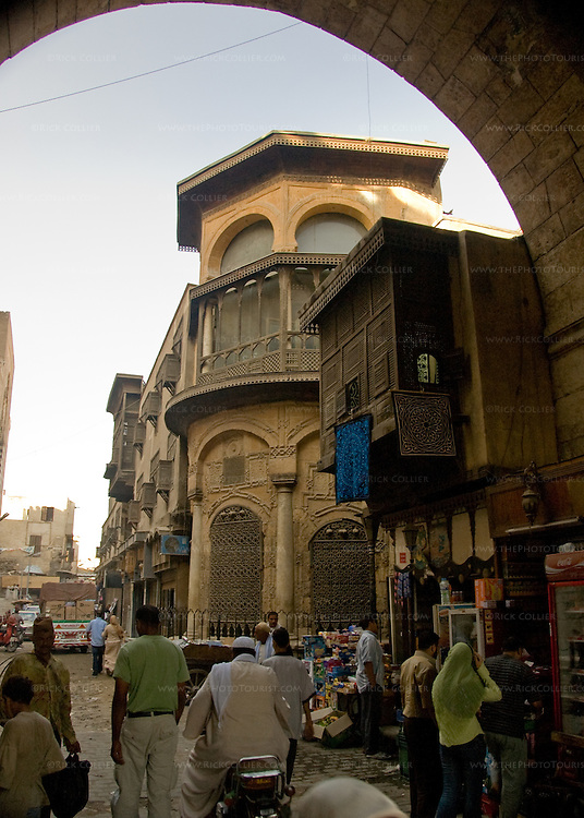 Islamic Cairo Street.  The streets of the original walled town of Cairo open to the visitor, entering through the gate at Bab Zwayla.  © Rick Collier.......Egypt Egyptian Cairo tourist tourism history historic antiquities Islamic old street shop window building city wall arch 'city gate' Zwayla 'Bab Zwayla'