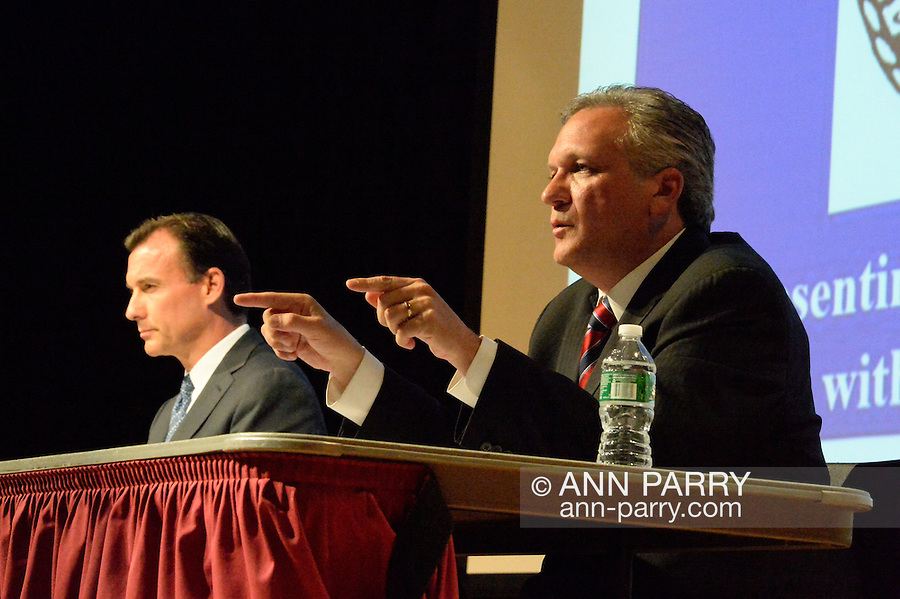 Old Westbury, New York, U.S. 8th October 2013. R-L, Republican EDWARD MANGANO, the Nassau County Executive, and Democrat THOMAS SUOZZI, the former County Executive, face each other in a debate hosted by the Nassau County Village Officials Association, representing 64 incorporated villages with 450,000 residents, as the opponents face a rematch in the 2013 November elections.