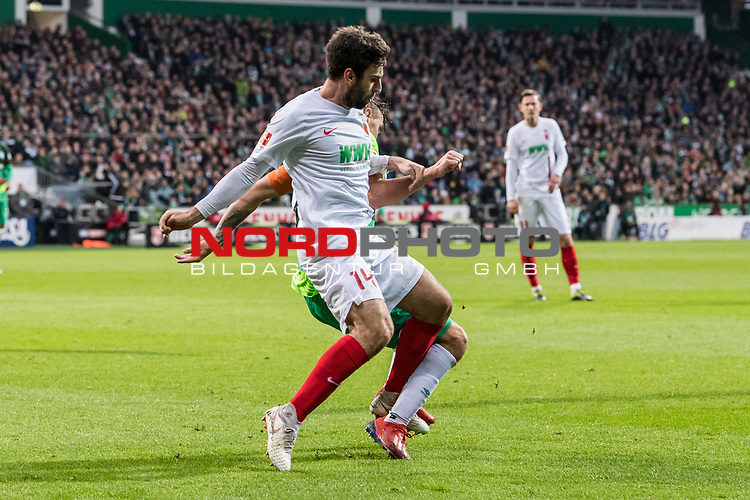 10.02.2019, Weserstadion, Bremen, GER, 1.FBL, Werder Bremen vs FC Augsburg<br /> <br /> DFL REGULATIONS PROHIBIT ANY USE OF PHOTOGRAPHS AS IMAGE SEQUENCES AND/OR QUASI-VIDEO.<br /> <br /> im Bild / picture shows<br /> Jan Moravek (FC Augsburg #14) im Duell / im Zweikampf / legt Max Kruse (Werder Bremen #10), <br /> <br /> Foto &copy; nordphoto / Ewert