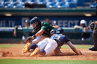 Jaime Ferrer (18) of TNXL Academy in Saint Cloud, FL fields a throw as Elijah Lambros (13) slides home during the Perfect Game National Showcase at Hoover Metropolitan Stadium on June 20, 2020 in Hoover, Alabama. (Mike Janes/Four Seam Images)