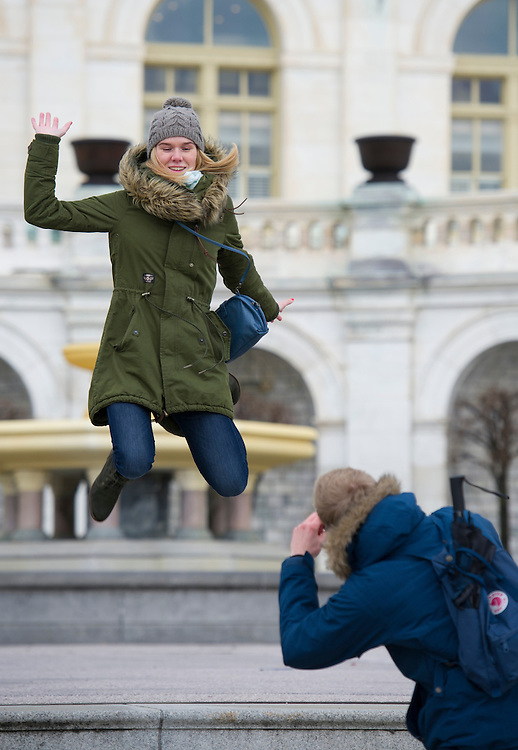 UNITED STATES - JAN 6: A tourist take photos of each other on the steps on the West Front of the U.S. Capitol on January 6, 2014. Storms over night brought heavy rain and melted all of the snow but temps tonight are expected to drop into the single digits with possible snow tomorrow.  (Photo By Douglas Graham/CQ Roll Call)