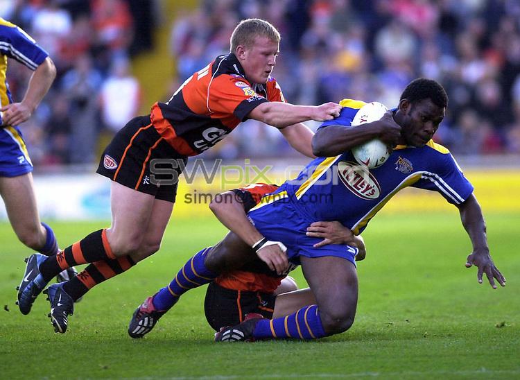 .Pix:Chris Whiteoak/SWpix.com - Leeds Rhinos v Castleford Tigers....Headingley, Leeds.......09/07/2004. ..COPYRIGHT PICTURE>>SIMON WILKINSON>>01943 608782>>..Leeds' Marcus Bai is tackled by Castleford's Luke Robinson (l) and Motu Tony