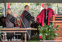 Trustee Susan DiMarco and President Jonathan Veitch confer an honorary degree to Secretary of Homeland Security Jeh Johnson at Occidental College's 133rd Commencement at the Remsen Bird Hillside Theater, on Sunday, May 17, 2015.<br /> (Photo by Marc Campos, Occidental College Photographer)