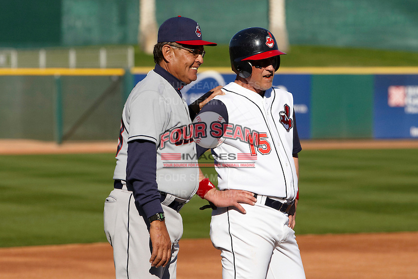 Former major league pitcher Sid Monge talks with a base runner during the campers vs pros game at the Cleveland Indians Fantasy Camp at Goodyear Stadium on January 19, 2012 in Goodyear, Arizona.  (Mike Janes/Four Seam Images)
