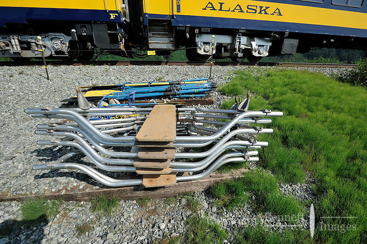 A pile of oars and rowing frames mark the Placer River takeout for rafting trips. The Alaska Railroad's Spencer Glacier Whistlestop train gives visitors access to hiking, camping and stunning views.