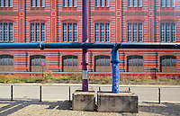 Pipes in front of the Bauakademie or Building Academy, originally built 1832-36 by Karl Friedrich Schinkel, home to architectural institutions and universities until it was demolished in 1962 and in 2000 this temporary structure was built resembling the original building, while plans to rebuild it are discussed, Berlin, Germany. Picture by Manuel Cohen