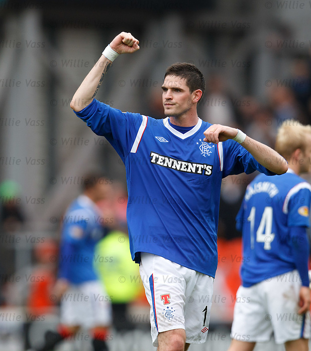 Kyle Lafferty celebrates to the Rangers fans