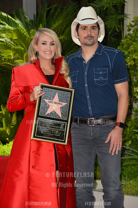 LOS ANGELES, CA. September 20, 2018: Carrie Underwood &amp; Brad Paisley at the Hollywood Walk of Fame Star Ceremony honoring singer Carrie Underwood.<br /> Pictures: Paul Smith/Featureflash
