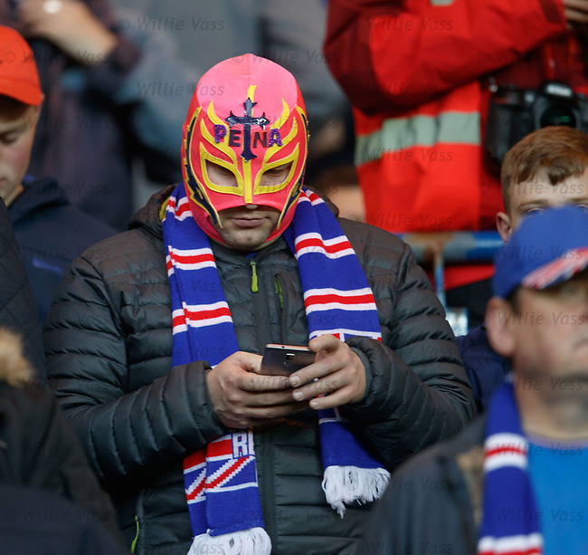 Rangers fan wearing a Carlos Prena mask during the second half of a 50k sellout at Ibrox Stadium