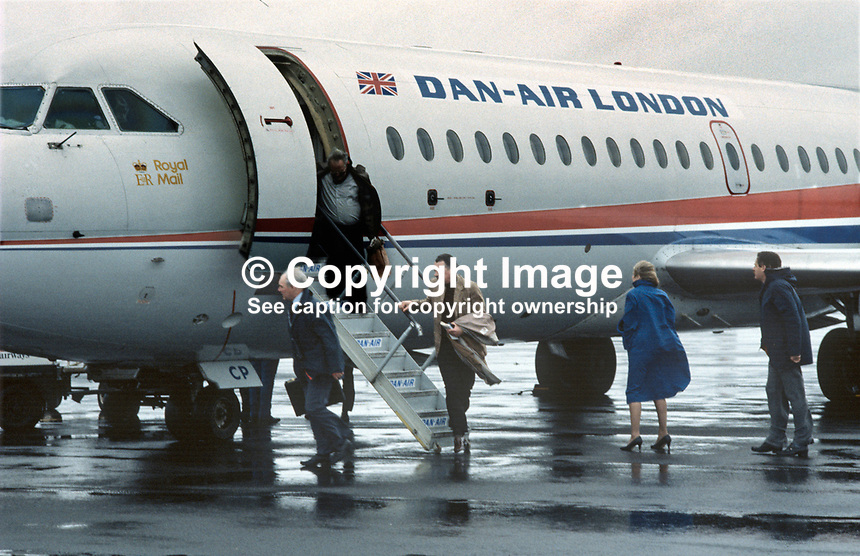 Passengers disembark from first Danair scheduled passenger flight from London Gatwick to Belfast International Airport, 6th February 1984. 19840015DAL2. The aircraft was a BAC 1-11.<br />
