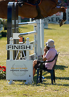 Athena rests during the wait for the horse to reach the finish line of the JMS Falsterbo Grand Prix. <br /> July 2006 at Falsterbo Horse Show, Vellinge, Sweden.<br /> Horse trials have since the 1920s proud traditions on the Falsterbo peninsula in southwestern Sweden, nowadays run as the international meeting Falsterbo Horse Show.<br /> In 2007 685 horses from 15 countries competed during the seven days of the meeting.<br /> July 2006.<br /> Only for editorial use.