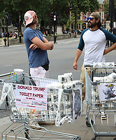 Two street traders in Westminster selling President Trump Toilet Paper. August 7th 2019<br /> <br /> Photo by Keith Mayhew