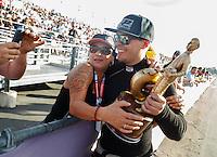 Feb 14, 2016; Pomona, CA, USA; NHRA top alcohol funny car driver Jonnie Lindberg celebrates after winning the Winternationals at Auto Club Raceway at Pomona. Mandatory Credit: Mark J. Rebilas-USA TODAY Sports