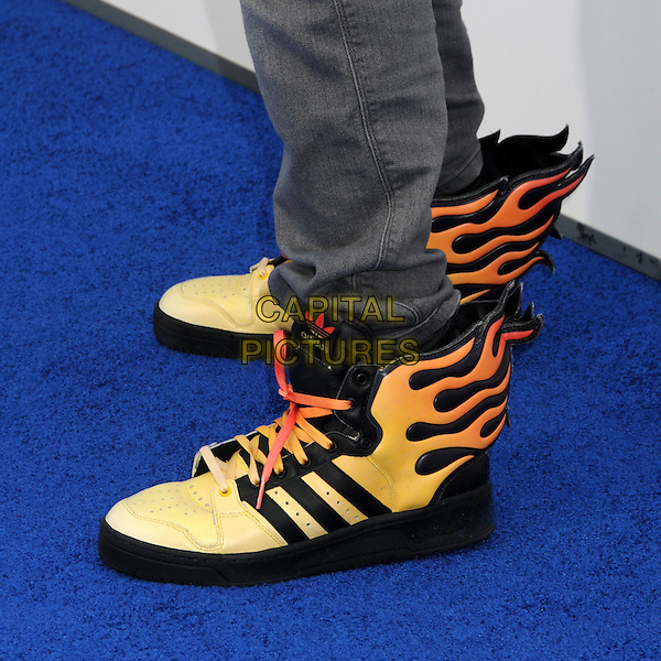 "WILL.I.AM'S TRAINERS of Black Eyed Peas (William James Adams Jr.).""Rio"" Los Angeles Premiere held at Grauman's Chinese Theatre,  Hollywood, California, USA, .10th April 2011.detail feet shoes flames wings orange black adidas .CAP/ADM/BP.©Byron Purvis/AdMedia/Capital Pictures."