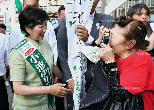 July 24, 2016, Tokyo, Japan - Former Japanese Defense Minister Yuriko Koike walks through Jizo Dori, a busy shopping street popular among the ?elderlies in Tokyos Sugamo area, on swealtering Sunday, July 24, 2016, campaigning for the July 31 Tokyo gubernatorial election. With the voting date one week away, Koike, 64, a newscaster-turned-politician is leading the race without support from her own party, the ruling Liberal Democratic Party. (Photo by Natsuki Sakai/AFLO) AYF -mis-