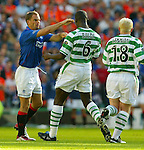 Ronald de Boer gives Bobo Balde a slap in an Old Firm encounter at Parkhead