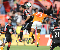 Dwayne De Rosario (7) of D.C. United heads the ball against Giles Barnes (23) of the Houston Dynamo. The Houston Dynamo defeated D.C. United 2-1, at RFK Stadium, Saturday October 27, 2013.
