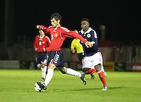 Islam Feruz pressures Hakob Loretsyan in the Scotland v Armenia UEFA European Under-19 Championship Qualifying Round match at New Douglas Park, Hamilton on 9.10.12.