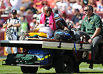 Green Bay Packers tight end Jermichael Finley is carted from the field against the Washington Redskins during the first quarter of the game at FedEx Field in Landover, Md., on Oct. 10, 2010.