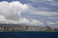Honolulu coastline with mountains in the background, taken from the water
