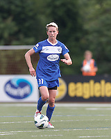Boston Breakers midfielder Joanna Lohman (11) brings the ball forward.  In a National Women's Soccer League Elite (NWSL) match, Sky Blue FC (white) defeated the Boston Breakers (blue), 3-2, at Dilboy Stadium on June 16, 2013.