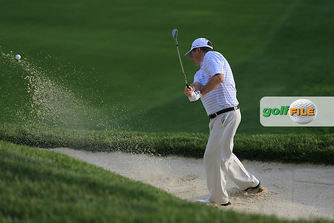 Tim Clark (RSA) ochips from a bunker at the 18th green during Thursday's Round 1 of the 95th US PGA Championship 2013 held at Oak Hills Country Club, Rochester, New York.<br /> 8th August 2013.<br /> Picture: Eoin Clarke www.golffile.ie