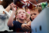 NWA Democrat-Gazette/CHARLIE KAIJO (Center left) Jones Geopfert, 6, of Farmington gets ice cream during the farmer's market, Saturday, July 7, 2018 at the Square in Bentonville. <br /><br />Area Farmers Markets are participating in a farmers market trail where patrons have passports that are stamped when they visit pariticipating markets. The event takes place through July and is an attempt to celebrate the diversity within the region&Otilde;s markets.