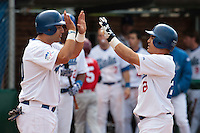 30 july 2010: Jairo Gizzi of Italy is congratulated by a teammate after scoring off an home run during Italy 9-2 win over France, in day 6 of the 2010 European Championship Seniors, at TV Cannstatt ballpark, in Stuttgart, Germany.